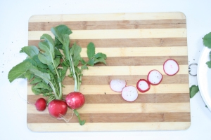 Photo of radishes on a chopping board